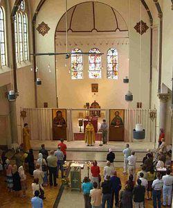 Амстердам во время проповеди за литургией