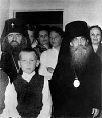 St. John, soon after his arrival in San Francisco, with Archbishop Tikhon (Troitsky). The author is at left in front of St. John.