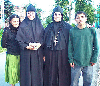 "Abbess Ines, Sister Maria, and two of the ""graduates"" of the orphanage, Reina and Edgar Rolando"