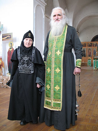 Archimandrite Athanasius and his mother, a schemanun at the convent.