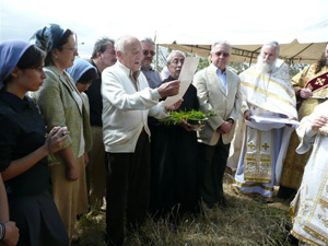 Placing the first stone in the foundation of the Vladimir Mother of God Church.