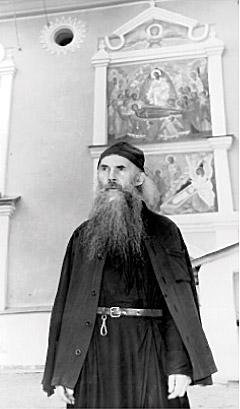 Archimandrite Seraphim (Rosenberg) in front of the Dormition Church, Pskov-Caves Monastery