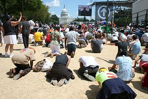 Tens of thousands of people kneel in prayer at TheCall DC on the National Mall, Saturday, Aug. 16, 2008.