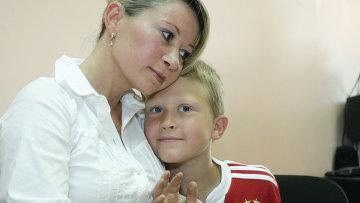 Россиянка Инга Рентала со своим сыном Робертом. Фото: Игорь Самойлов / РИА Новости