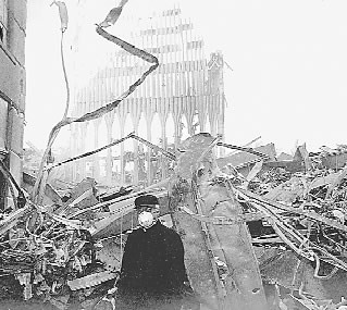 Fr. John Romas, pastor of St. Nicholas, stands by the ruins of the church shortly after the terrorist attacks of September 11.