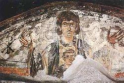 Загрузить увеличенное изображение. 450 x 300 px. Размер файла 38457 b.  Богоматерь с младенцем Иисусом. Катакомбы Присциллы в Риме. 3 в.