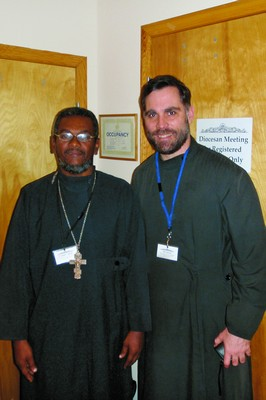 Священник Грегуар Легутэ и Джон Свенсен