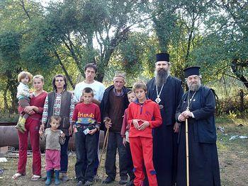 Archimandrite Nektarios (Serfes) with Bishop Teodosije (Sibalic), now bishop of Raska-Prizren and Kosovo Metohija, distributing food to families in 2006.