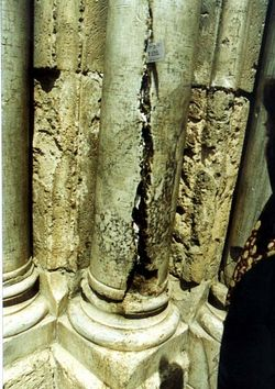 The column at the gates of the Church, with the fissure.