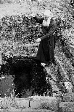 Fr. Deiniol blessing St. Engan's Well, Llanengan.