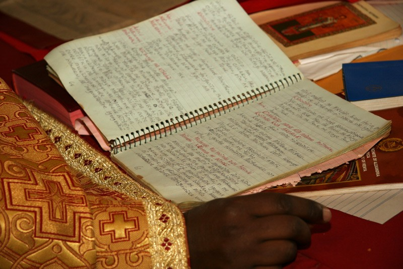 Handwritten service books. In Kenya, service books are published in local languages, but not every parish can afford to buy them. Priests rely more often on the handwritten notebooks they have been using for many years.  Photo: Denis Makhanko