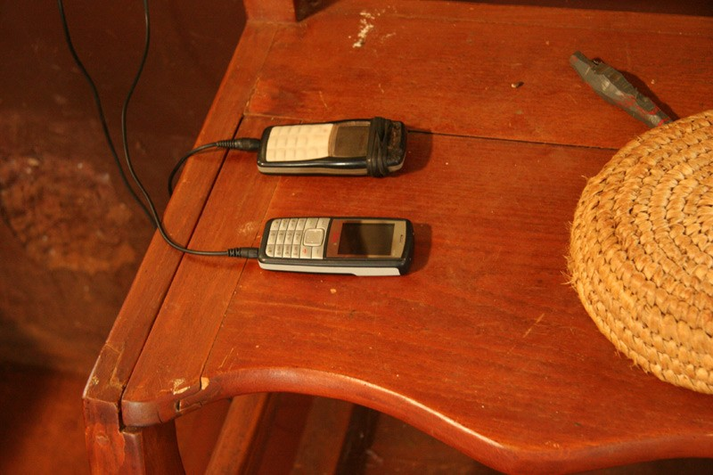 Hope for the Kikuyu.  Parishioners who do not have electricity at home bring their mobile phones to church for a charging.  Photo: Denis Makhanko