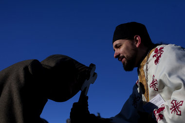 PAUL CHAPLIN, The Patriot-NewsAfter blessing the Susquehanna River, Father Stephen Vernak of Christ the Savior Orthodox Church in Harrisburg offers a final blessing.