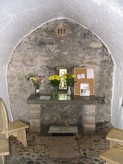 Inside St. Trillo's chapel. The well is under the altar.