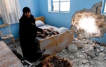 Sr Verona, head of the Saydnaya convent, in a room in the convent that was damaged in a mortar attack. Photograph: Bassem Tellawi/AP