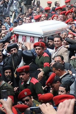 Egyptian soldiers carry the coffin of Pope Shenouda III, the head of Egypt's Coptic Orthodox Church, during his funeral in the Abassiya Cathedral in Cairo March 20, 2012.
