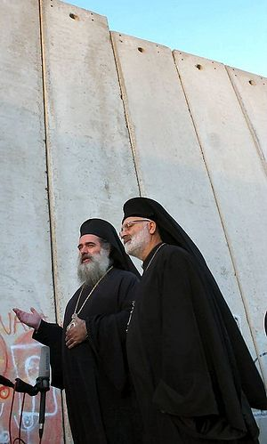 Archbishop Theodosius Atallah Hanna beside Israel's wall in Bethlehem | June 4, 2011