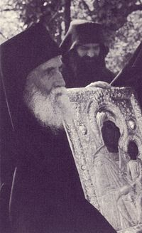 "St. Paisios with the icon of the Mother of God ""Axion Estin"" (It is Truly Meet)."
