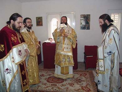 Archbishop Jovan serving Divine Liturgy in the St. Nectarios Chapel before its destruction.