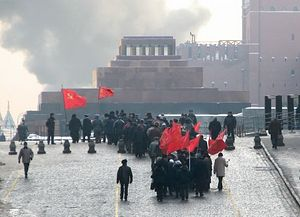 Communist Party supporters marching toward Lenin's mausoleum on Red Square