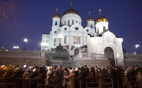 Russian Orthodox believers brave frosty weather to stand in line outside the Christ the Savior Cathedral, in Moscow, in November 2011. Photo: Associated Press.