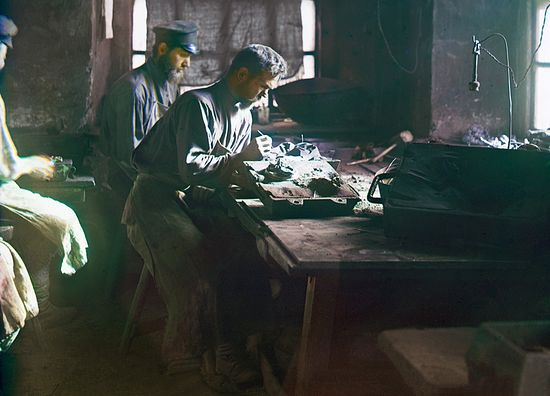 Fashioning a mold for an art casting. Photo by S. M. Prokudin-Gorsky, 1910