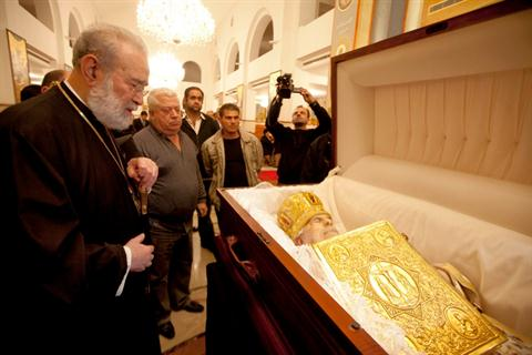 Greek Orthodox Archbishop of Beirut Elias Audi stands next to the body of Orthodox Patriarch of Antioch and the whole East Ignatius Hazim IV as the body lies in state at Saint Nicolas Church in Ashrafieh district, East Beirut December 5, 2012. Photo: The Daily Star/Mahmoud Kheir.