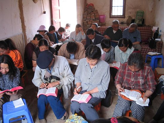 A group of Christians studying the Bible in China.