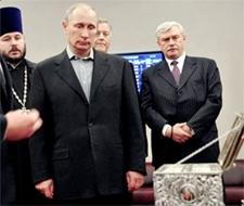 Vladimir Putin contemplates a holy relic.