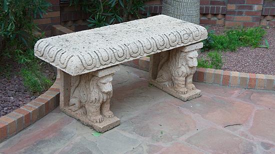 Каменные скамейки в монастырском саду.