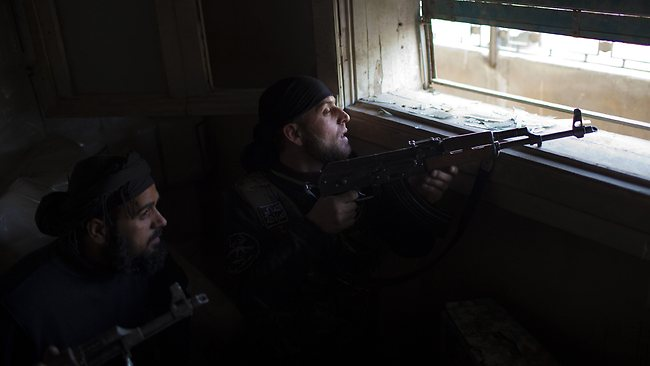 Syrian rebels take position as they monitor the movement of regime forces in the old city of Aleppo in northern Syria on March 11. Picture: AFP
