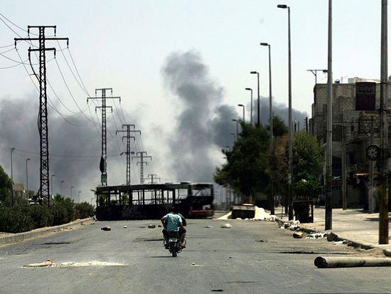 Патруль оппозиционеров в окрестностях Алеппо. Август 2012 г. Фото: AFP