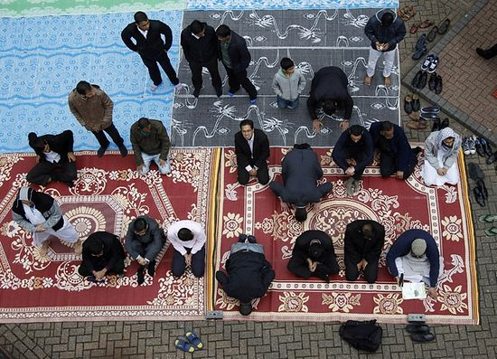 Muslims attend Friday prayers on the first day of Ramadan, in the courtyard of a housing estate next to a small BBC community centre and mosque in east London (Reuters)