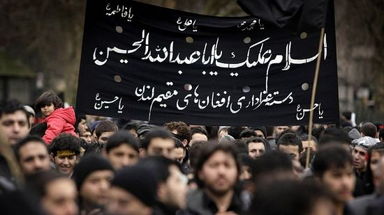 Shiite Muslims gather in Hyde Park in West London to mark the final day of Ashura. (AFP Photo/Shaun Curry)