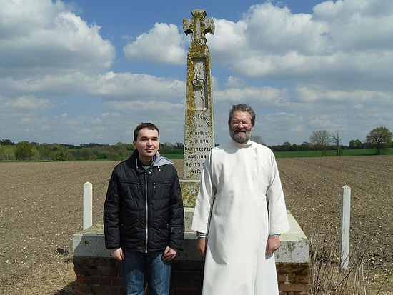 Author Dimitry Lapa with Archpriest Andrew Phillips at the cross of St. Edmund in Hoxne.