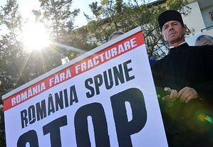 Vasile Laiu, the Christian Orthodox archpriest of Barlad, takes part in a protest against shale gas exploition next to a pancarte reading in Romanian