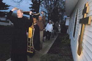 Subdeacon David Gresham leads a procession of the shroud May 2 at Holy Apostles Orthodox Church in Normal. Father Danial Doss (behind Gresham) said the procession commemorates the burial of Jesus Christ after the Crucifixion.