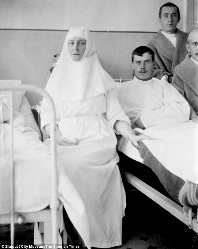 Tsarina Alexandra is seen on a hospital visit to injured servicemen.