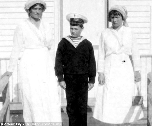 In this 1914 picture, four years before their execution, Nicholas's heir Alexei is seen with sisters Olga, left, and Tatiana, right.