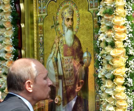 Russian President Vladimir Putin kisses an icon during a service and ceremony in Kyiv on July 27 to celebrate the 1,025th anniversary of Christianity in Ukraine, Belarus, and Russia.