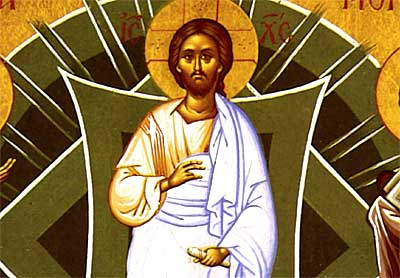 1. Christ appears in the center of the icon blessing with His right hand
