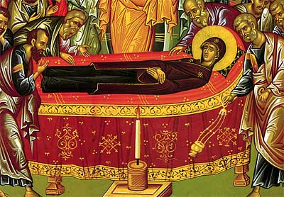 5. The Theotokos lies in the center of the icon surrounded by the Apostles and a candle in front of her bed (detail).