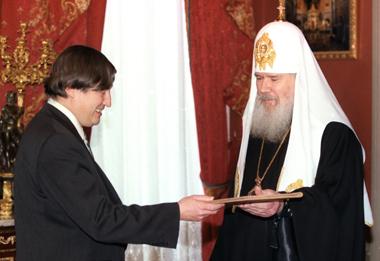 Анатолий Карпов и Патриарх Алексий II. 1999 г. Фото ИТАР-ТАСС.