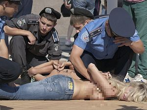 Femen members being arrested during one of their protests in Kiev. Photo: Dmitry Shakin/Flickr