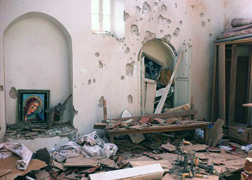 A church in the Syrian village of al-Duwayr, after an attack by Islamist militiamen. (Image credit: Syria Report)
