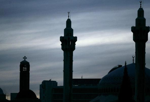 The King Abdullah mosque (R) and an Orthodox church(L) in Amman December 18, 2007. REUTERS/Muhammad Hamed