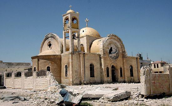 Поврежденный храм в Сирии.