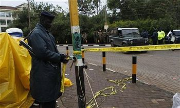 A Kenyan policeman secures the road past the Westgate Shopping Centre. Photo: REUTERS/Thomas Mukoya