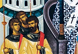 3. Deacons can be seen holding candles while coming to venerate the Holy Cross (detail)