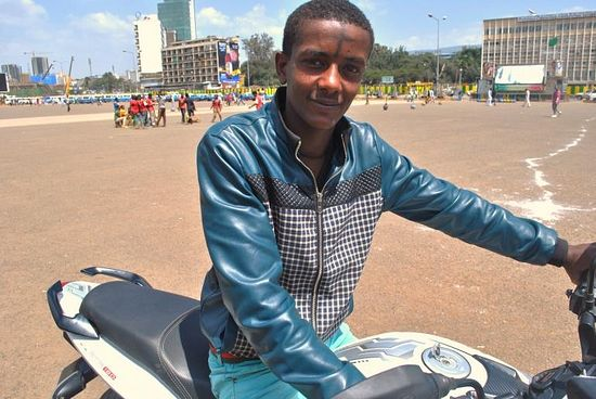 A young man wearing the sign of the cross rides his motorcycle around Meskel Square on Sept. 27, 2013. Photo: IBTimes/Jacey Fortin